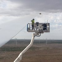 a blade wind services blade tech carrying out rotor blade repair to a wind turbine